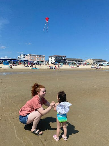 mama and baby curly hair beach